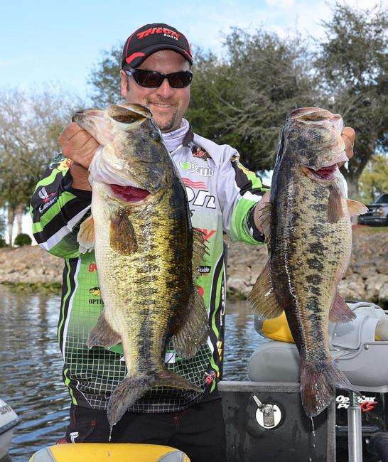 Second-place pro Fred Roumbanis holds up his two biggest bass from day two on Lake Okeechobee.