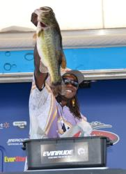 Third-place co-angler Anthony Hunt holds up his biggest from day three on Lake Okeechobee.