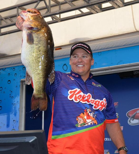 Terry Scroggins shows off a 12-pound, 2-ounce bass he caught on day four of the FLW Tour event on Lake Okeechobee.
