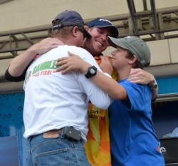 Pro winner Brandon McMillan celebrates with his father and brother after winning the 2011 FLW Tour opener on Lake Okeechobee.