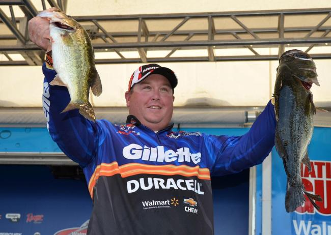 Fifth-place pro Jacob Powroznik holds up his two biggest bass from day four on Lake Okeechobee.
