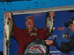Pro winner Ken Howden shows off two of the big bass he caught on day three.