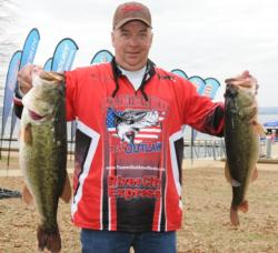 Steve Keller of Bethel, Ohio, leads the Co-angler Division of the EverStart event on Lake Guntersville with 24 pounds, 14 ounces, which included a 10-pounder.