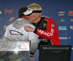 Pro winner David Ryan gets a congratulatory hug from Roy Hawk who led on days one and two.
