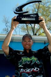 Pro Todd Castledine of Nacogdoches, Texas, proudly displays his first-place trophy after winning the EverStart Series event on the Toledo Bend Resevoir.