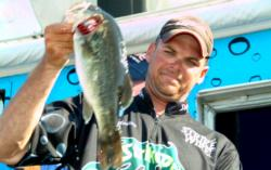 Pro Todd Castledine of Nacogdoches, Texas, weighs in his first-place catch during the final day of competition on Toledo Bend.
