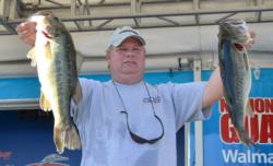 Mike Reynolds caught a 21-pound, 15-ounce limit Thursday and finished the day in second place.