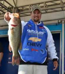Second-place co-angler Jade Keeton holds up his kicker from Friday