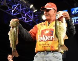 Second-place pro Tom Monsoor holds up his two biggest bass from day three on Lake Hartwell.