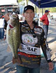 Fifth-place pro Kevin Hawk holds up his biggest bass from day one on Lake Chickamauga.
