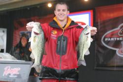 A drenched but happy Ryan Latinville holds up two bass that helped him move from third to first in the Eastern Division. For his efforts, Latinville earned a slot in the final day of the TBF National Championship.