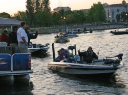 Pro Ken Mah and co-angler Chris Ricci make their way through boat check.