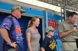 Sgt. 1st Class Lisa Merrill of the Utah National Guard and her son, 11-year-old Tyson Merrill, both of Gainesville, Va., carefully check the scales during the National Guard FLW Soldier Appreciation tournament at the Potomac River.