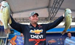Chevy pro Luke Clausen of Otis Orchards, Wash., shows off his first-place stringer shortly before capturing the tournament title at the FLW Tour Potomac River event.
