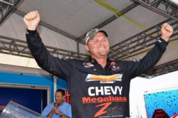 Chevy pro Luke Clausen of Otis Orchards, Wash., raises his hands in victory after capturing the tournament title at the FLW Tour Potomac River event.