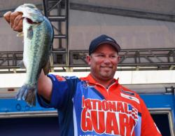Pro Bobby Lane of Lakeland, Fla., shows off his third-place catch at the FLW Tour Potomac River event.