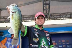 Stetson Blaylock of Benton, Ark., holds up part of his sixth-catch at the FLW Tour Potomac River event.