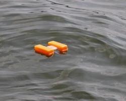 Marker buoys help anglers line up for effective presentations to hot spots they locate by sonar.