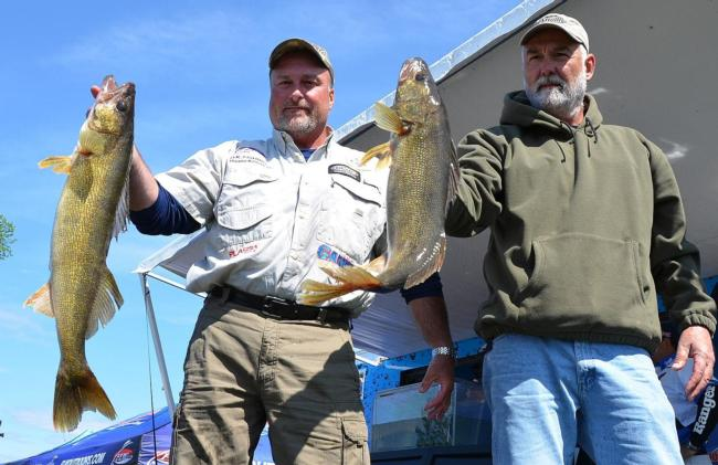 Pro Duane Kriese and co-angler Dan Soehren hold up their two