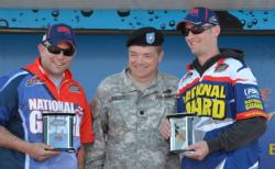 Lt. Col. Jacob Kulzer  presents Sgt. 1st Class Eric Oye and Staff Sgt. Steven Rime with their trophies for winning the National Guard FLW Soldier Appreciation Tournament held on Leech Lake.