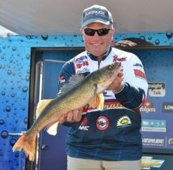 Fifth-place pro Eric Olson holds up his biggest fish from day three on Leech Lake.