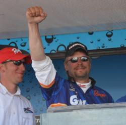 Kevin Carstensen celebrates after winning the FLW Walleye Tour qualifier on Leech Lake.