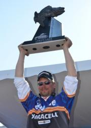 Leech Lake champion Kevin Carstensen holds up his trophy.