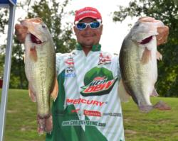 Third-place pro Jason Christie holds up part of his 23-pound, 1-ounce stringer.