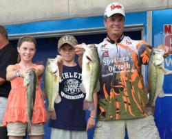 With some help from his daughter Rachel and his son Caleb, second-place pro Glenn Chappelear holds up his day-two catch.