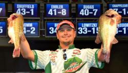 Fifth-place pro Jason Christie holds up his two biggest bass from day three on Kentucky Lake.