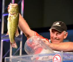Fifth-place pro Tom Monsoor holds up his biggest bass from day four on Kentucky Lake.