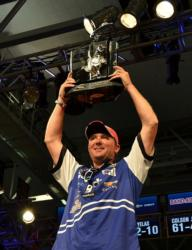 Chad Grigsby holds up his trophy for winning the FLW Tour event on Kentucky Lake.