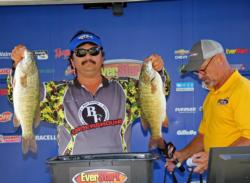 Second-place co-angler, Arnold Payne caught the biggest bass of his division, a 5-15.