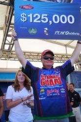 Mark Rose of Marion, Ark., proudly displays his first-place check after winning the FLW Tour event at Pickwick Lake.
