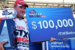 David Dudley of Lynchburg, Va., shows off his 2011 FLW Tour Angler of the Year trophy during the final day of Pickwick Lake action.