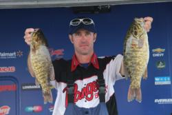 Day-one leader Jeff Hippert slipped to second on day two, but he trails by only 5 ounces.