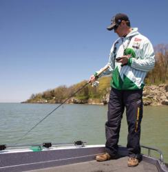 Fishing from the stern while steering the bowmount by remote gives FLW Walleye Tour pro John Balla enhanced control over his lines when making tight turns.