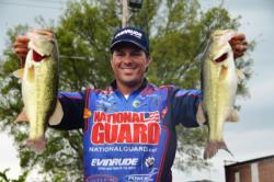 Pro Scott Martin of Clewiston, Fla., holds up his first-place catch during the opening day of 2011 Forrest Wood Cup competition at Lake Ouachita.
