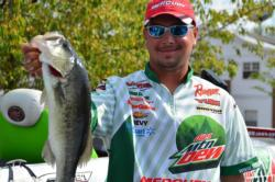 Day-two Forrest Wood Cup leader Jason Christie shows off his catch.