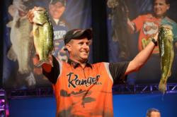 Co-angler Jeffrey Cummins shows off his 17-pound, 11-ounce sack during the second day of Cup competition.
