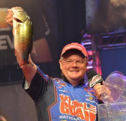 Third-place pro Mark Rose holds up his biggest bass from day four on Lake Ouachita.