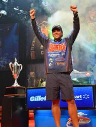 Scott Martin raises his arms in victory shortly after winning the 2011 Forrest Wood Cup title on Lake Ouachita.