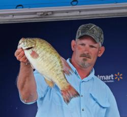 Second-place co-angler Milton Goff shows off a nice smallie on day three.