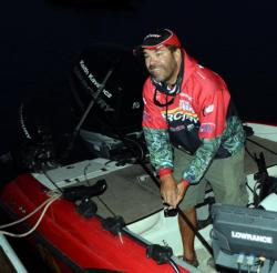 Right behind Chase Parsons is his uncle and fellow walleye pro Keith Kavajecz, who readied his rods before takeoff on Lake Oahe.