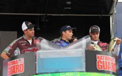 Ramapo College bass club president Bob Rieder looks on as his partner Charles Danza pulls a pair of bass from his bag.