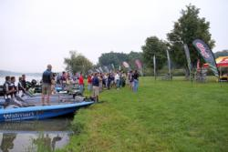 Anglers, volunteers and spectators pause for the national anthem prior to the final day