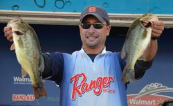 Second-place co-angler Christopher Hall holds up his two biggest bass from day three on Lake Champlain.