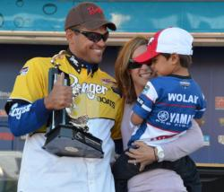 Pro winner David Wolak celebrates his Lake Champlain victory with his wife and son.