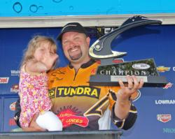 Pro winner Michael C. Tuck celebrates his victory with his 3-year-old daughter Reagan.