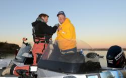 Evinrude pro Tommy Skarlis is outfitted with a microphone for TV production prior to takeoff.